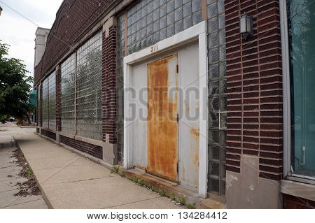 JOLIET, ILLINOIS / UNITED STATES - MAY 24, 2015: An abandoned building sits empty in downtown Joliet.