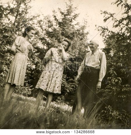 LODZ, POLAND, CIRCA 1940's: Vintage photo of family outdoor