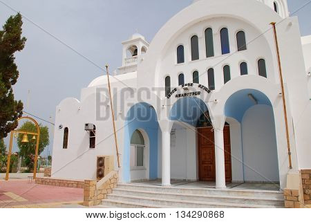 AGISTRI, GREECE - MAY 12, 2016: The domed church of Agioi Anargyroi at Skala on the Greek island of Agistri. The small island is under an hour from Piraeus harbour in Athens.