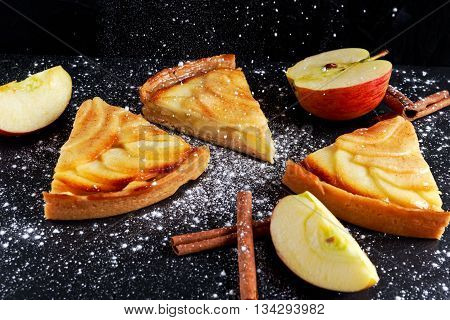 Slice of Golden Bramley apple tart with cinnamon glaze.