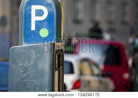 Automatic charge a fee for parking paid parking for cars in city. Parking fees.