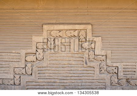 South America Peru Chan Chan is the largest pre-Columbian city in the Americas and the largest adobe city in the world. Fragment of ornaments of the wall of clay surrounding the city