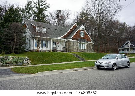 HARBOR SPRINGS, MICHIGAN / UNITED STATES - DECEMBER 24, 2015: A large home, under the bluff on Fourth Street in Harbor Springs, during December.
