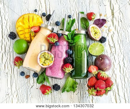 Berry and fruit smoothie in bottles healthy summer detox yogurt drink diet or vegan food concept fresh vitamins homemade refreshing cocktail