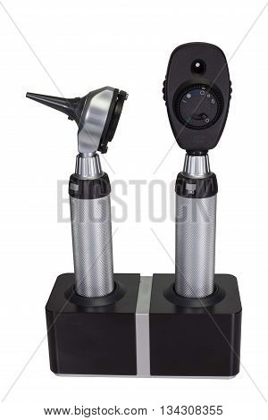 Otoscope and Ophthalmoscope in charger stand on white background.
