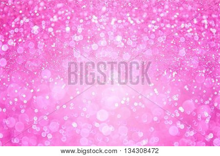 Pink glitter sparkle background or confetti princess girl party invitation