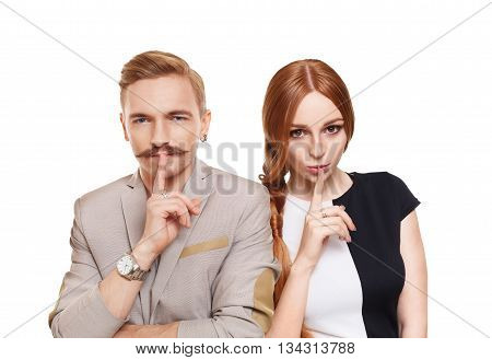 Woman and man keep secret. Couple shows hush sign, adultery, relationship issue, marriage cheating concept. Secret love, jealousy. Mystery, privacy, intimacy. Young beautiful couple isolated at white