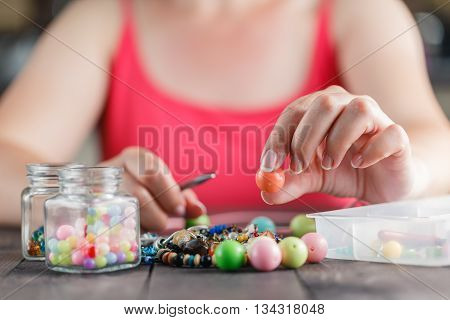 Woman Designing Colorful Necklace With Plactic Beads