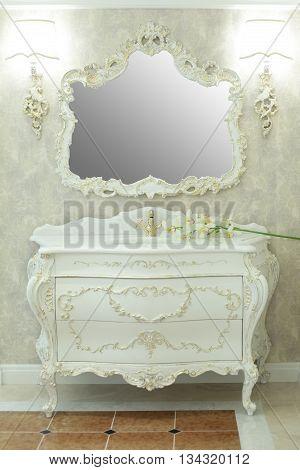 Royal bathroom interior - marble tiles and mirror