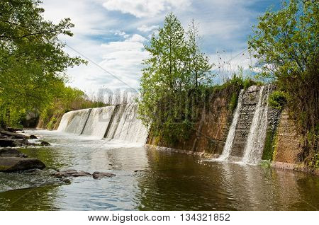 The beautiful waterfall in spring sunny day