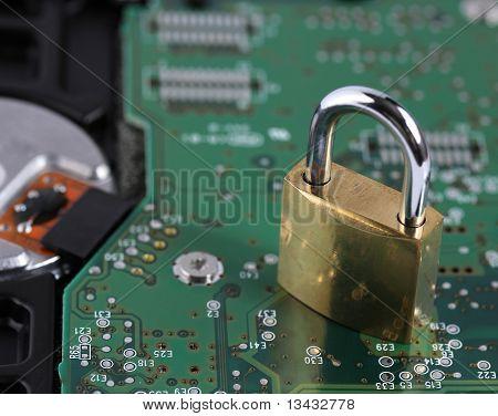 Padlock And Computer Hard Disk Drive