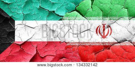 Kuwait flag with Iran flag on a grunge cracked wall