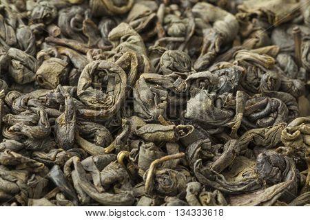 Green gunpowder tea pellets full frame close up