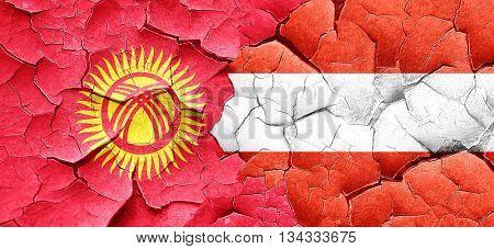 Kyrgyzstan flag with Austria flag on a grunge cracked wall