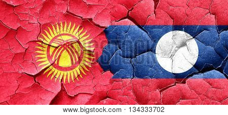 Kyrgyzstan flag with Laos flag on a grunge cracked wall
