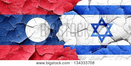 Laos flag with Israel flag on a grunge cracked wall