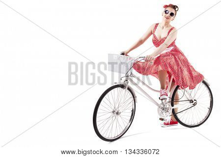 Pin up girl posing with a vintage bicycle, isolated on white background