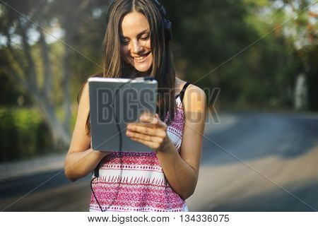 Woman Connecting Tablet Listening Music Concept
