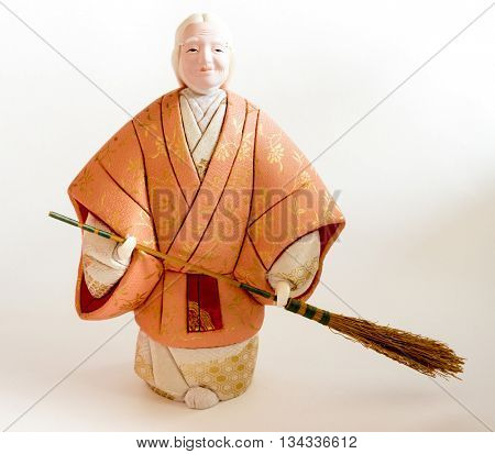 "GOMEL, BELARUS - MAY 24, 2015: The Antique Kimekomi Japanese doll old woman Uba depicting a Noh play, ""The Old Couple from Takasago"". Japanese traditional dolls are known by the name ningyo in Japan."