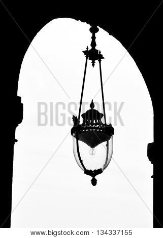 Vintage lamp at the Palais-Royal in Paris, France. Black and white photography.