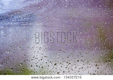 Raindrops on the glass.