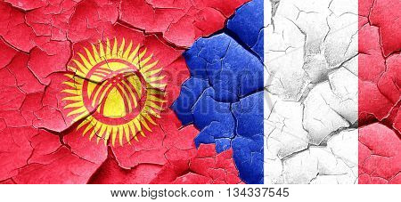 Kyrgyzstan flag with France flag on a grunge cracked wall