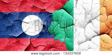 Laos flag with Ireland flag on a grunge cracked wall