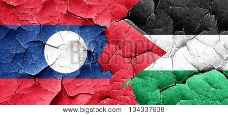Laos flag with Palestine flag on a grunge cracked wall