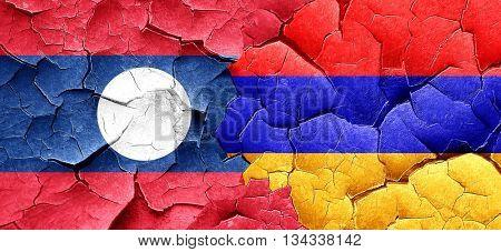 Laos flag with Armenia flag on a grunge cracked wall