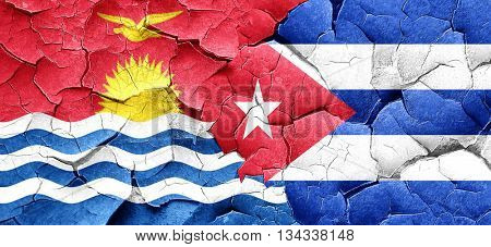 Kiribati flag with cuba flag on a grunge cracked wall