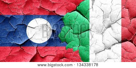 Laos flag with Italy flag on a grunge cracked wall