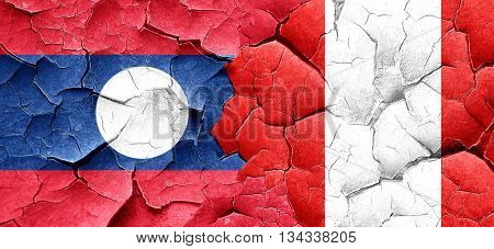 Laos flag with Peru flag on a grunge cracked wall