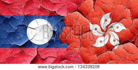 Laos flag with Hong Kong flag on a grunge cracked wall