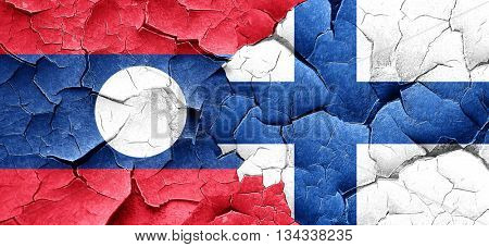 Laos flag with Finland flag on a grunge cracked wall