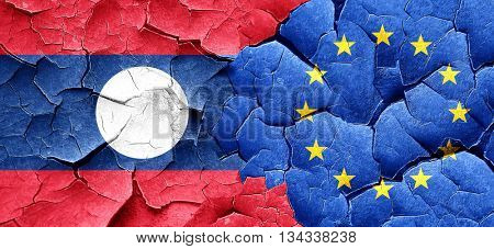 Laos flag with european union flag on a grunge cracked wall