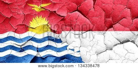 Kiribati flag with Indonesia flag on a grunge cracked wall