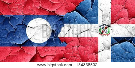 Laos flag with Dominican Republic flag on a grunge cracked wall
