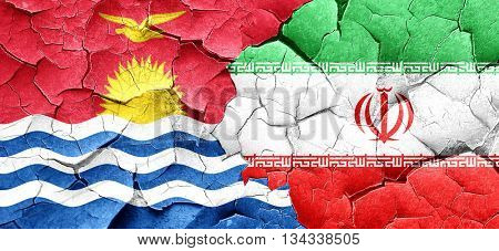 Kiribati flag with Iran flag on a grunge cracked wall