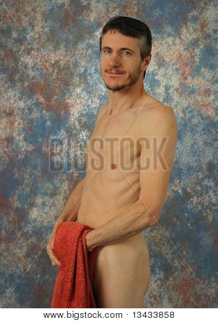 Nude Muscular Man With A Red Towel.