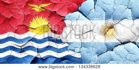 Kiribati flag with Argentine flag on a grunge cracked wall