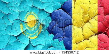 Kazakhstan flag with Romania flag on a grunge cracked wall