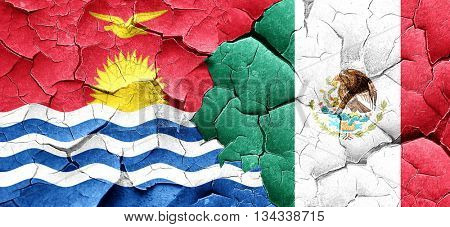 Kiribati flag with Mexico flag on a grunge cracked wall