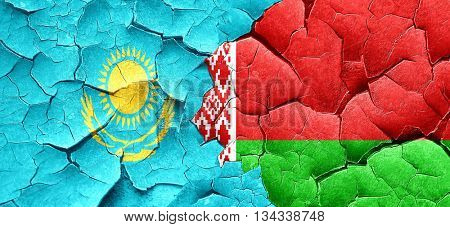 Kazakhstan flag with Belarus flag on a grunge cracked wall