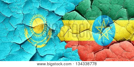 Kazakhstan flag with Ethiopia flag on a grunge cracked wall