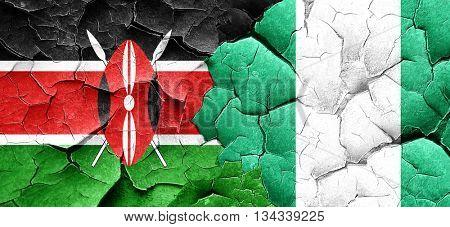 Kenya flag with Nigeria flag on a grunge cracked wall