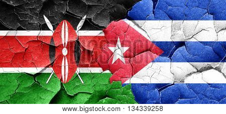 Kenya flag with cuba flag on a grunge cracked wall