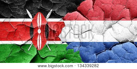 Kenya flag with Netherlands flag on a grunge cracked wall