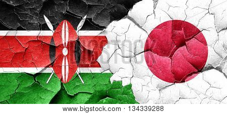 Kenya flag with Japan flag on a grunge cracked wall