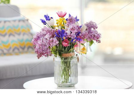 Bouquet of fresh spring flowers in the room