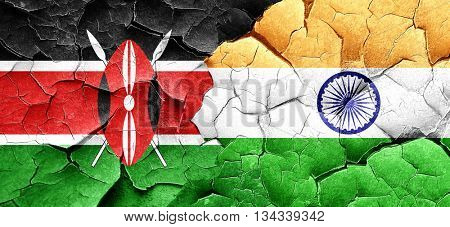 Kenya flag with India flag on a grunge cracked wall